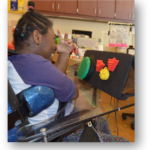 jade, using the 3d symbols mounted onto her wheelchair