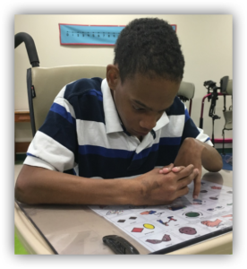 harold using core vocabulary communication board